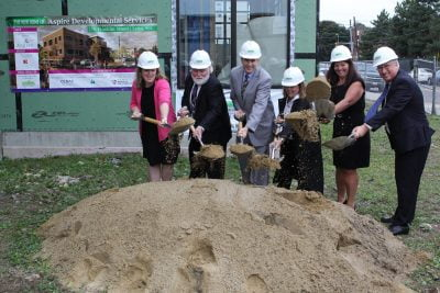 Annie Walsh, Board Chair, Aspire Development Services, William Concannon, Deputy Commissioner Administration and Finance, Commonweath of Massachusetts, Roger Herzog, Executive Director, Community Economic Development Assistance Corporation and Children's Investment Fund, Mayor Judith Flanagan Kennedy, Lori Russell, Acting Executive Director, Aspire, and State Senator Thomas McGee at the ground breaking ceremony of the new Aspire Developmental Service headquarters on Franklin Street in Lynn.