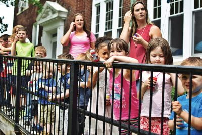 Students of the Monument Square Early Childhood Center at Child Care of the Berkshires lined up outside the Haskins facility on Thursday to celebrate more than $1 million in renovations announced for the school building. Thursday, June 8, 2017. Adam Shanks — The Berkshire Eagle